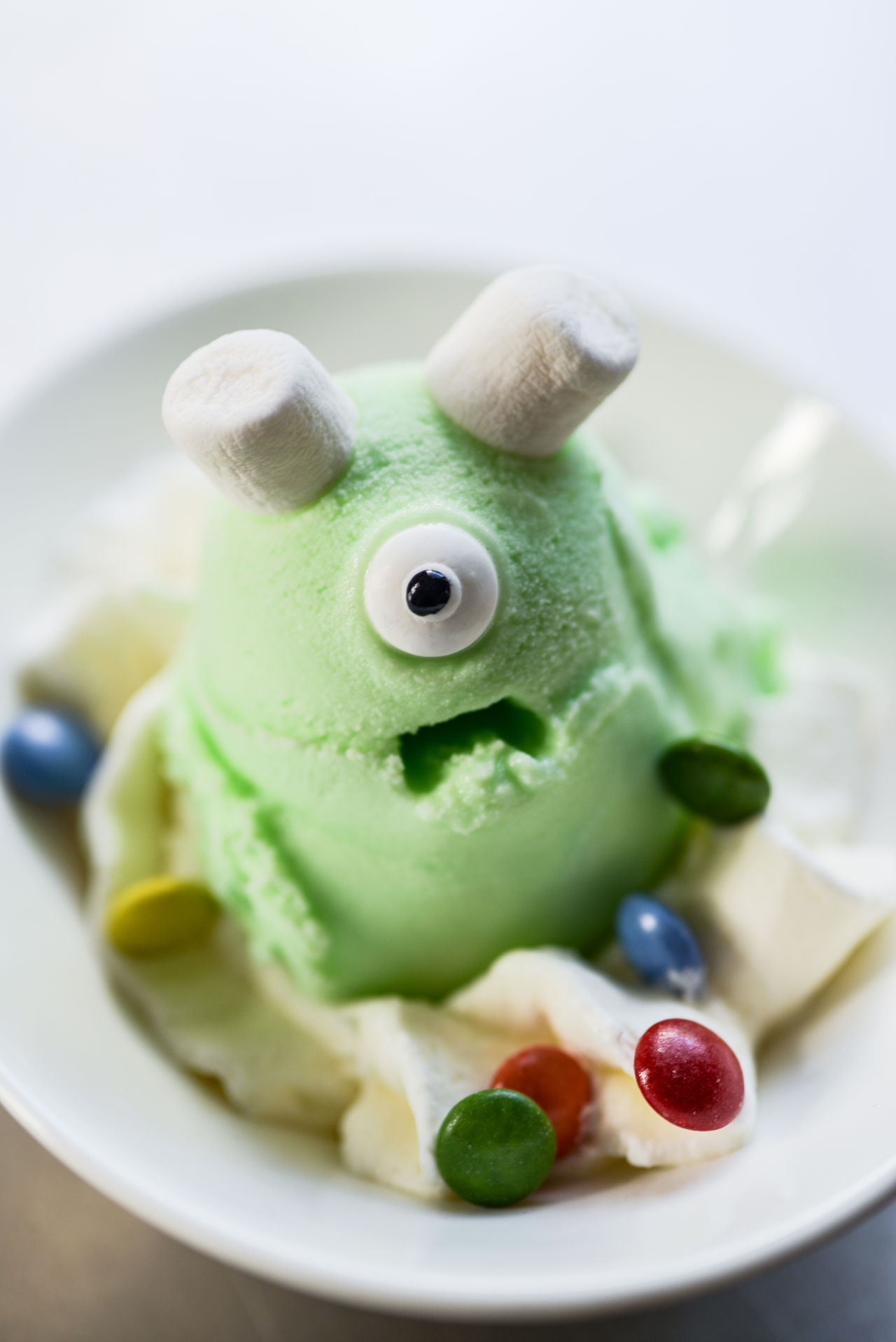 Close-up Day Dessert Eye Face Food Food And Drink Freshness Gelato Green Color Ice Cream Ice Monsters Indoors  Indulgence Mouth Open No People Plate Ready-to-eat Selective Focus Still Life Sweet Food Temptation Unhealthy Eating Visual Feast