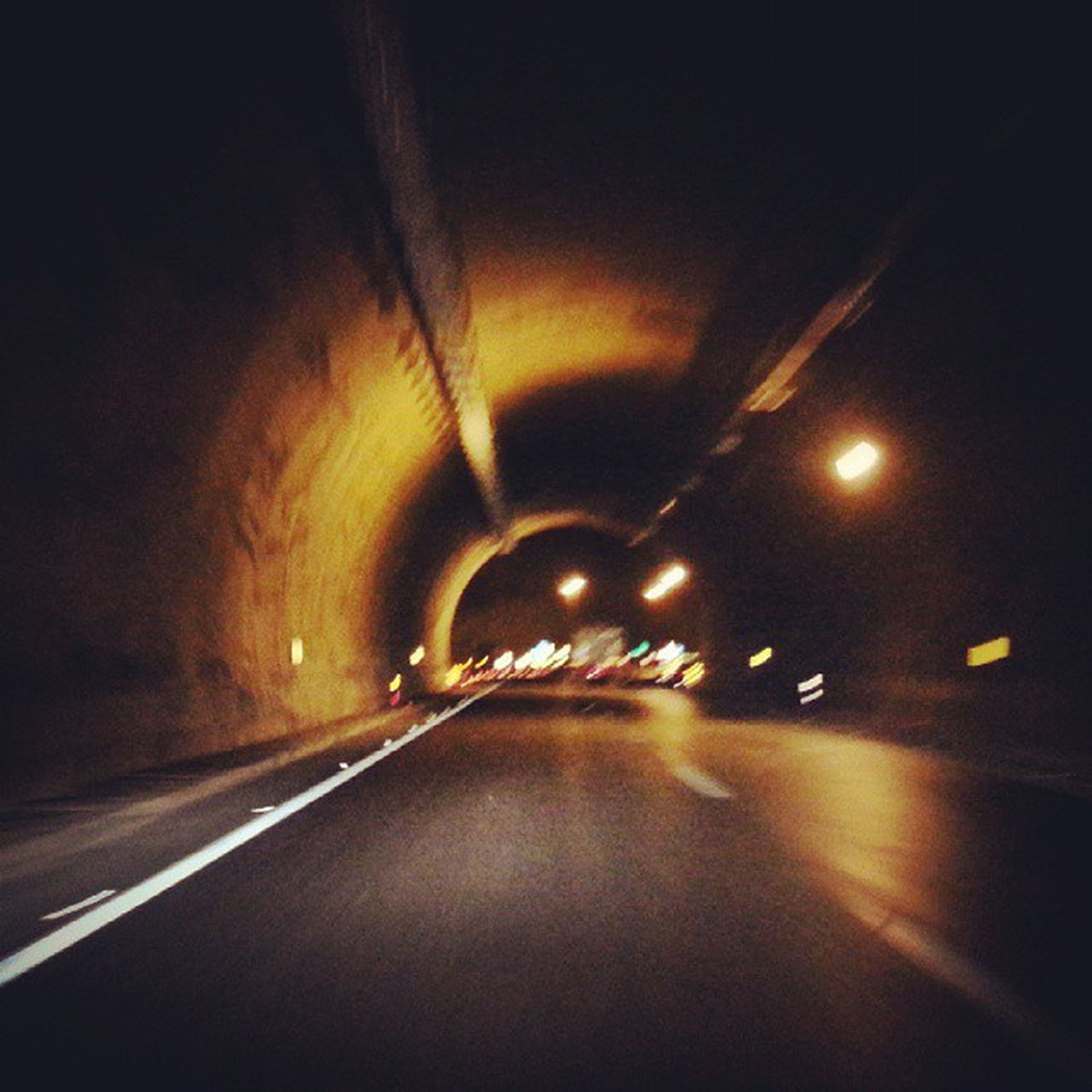 illuminated, the way forward, night, diminishing perspective, transportation, vanishing point, road, tunnel, lighting equipment, indoors, road marking, empty, street, long, street light, light - natural phenomenon, no people, dark, empty road, electric light