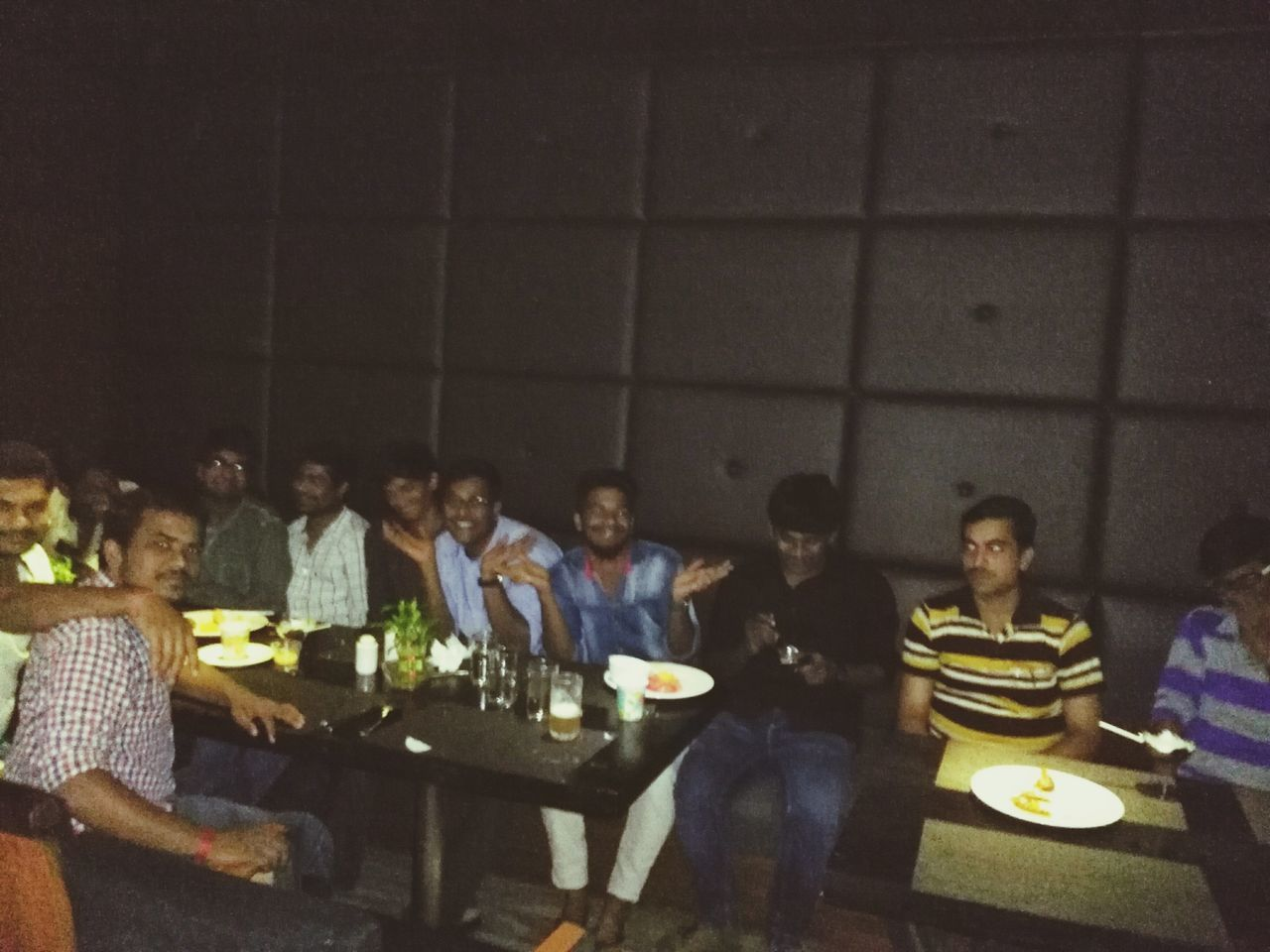 large group of people, real people, food and drink, togetherness, sitting, indoors, lifestyles, night, men, friendship, illuminated, women, social gathering, food, young adult, people
