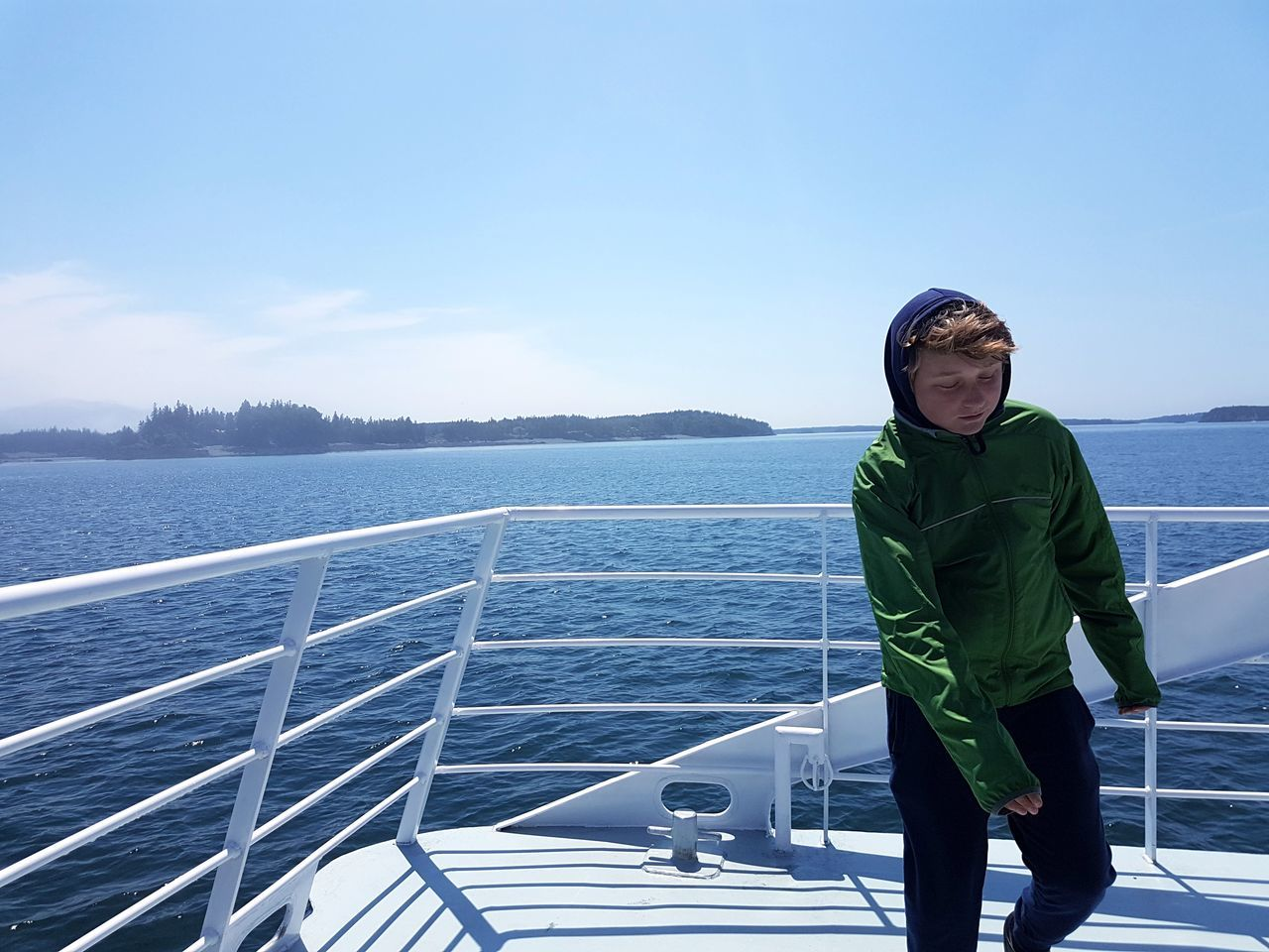 sea, real people, water, one person, lifestyles, leisure activity, nautical vessel, standing, nature, sky, outdoors, day, beauty in nature, sailing, men, horizon over water, vacations, boat deck, young adult, people