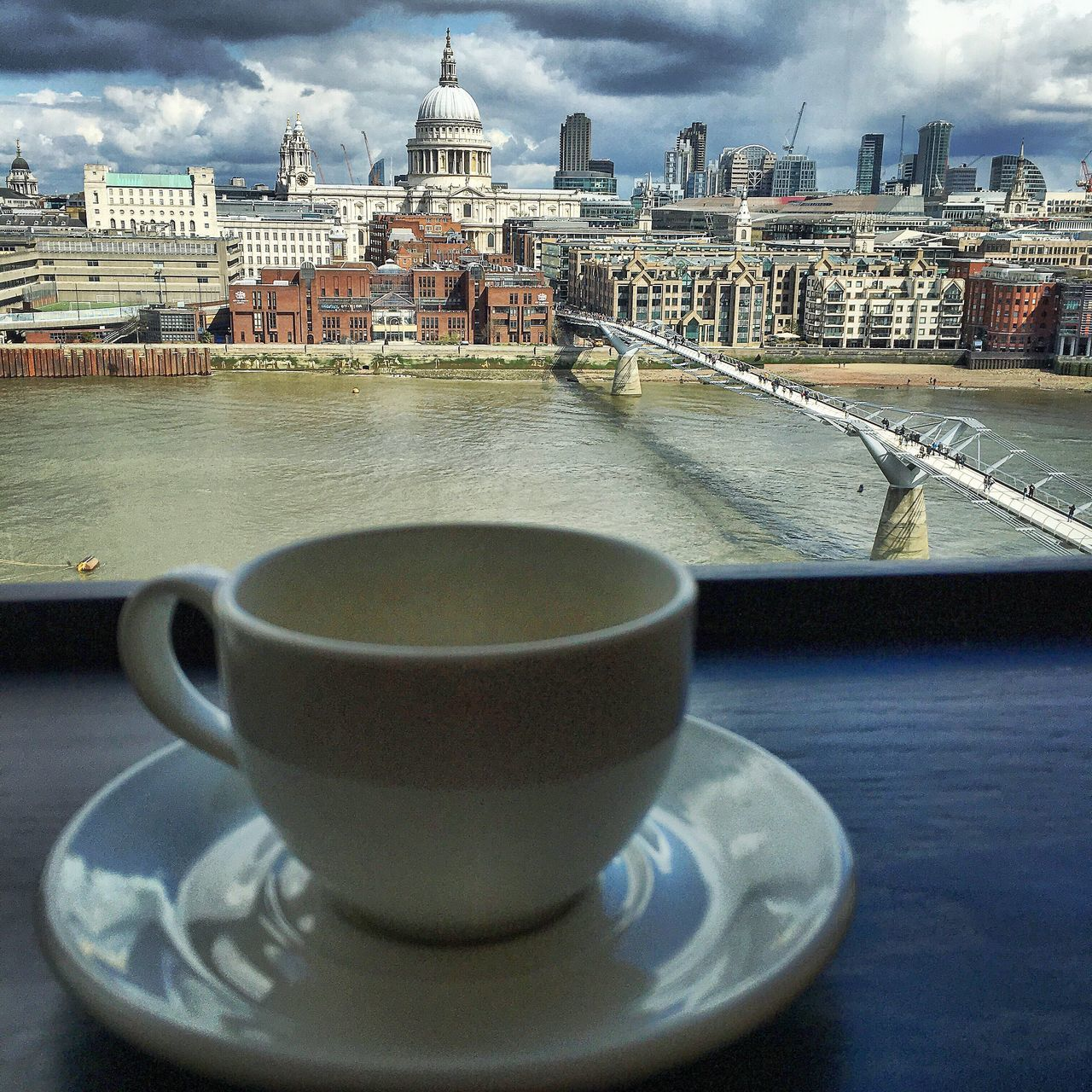 refreshment, drink, architecture, building exterior, coffee cup, built structure, food and drink, sky, coffee - drink, water, day, table, no people, dome, outdoors, close-up, city, freshness
