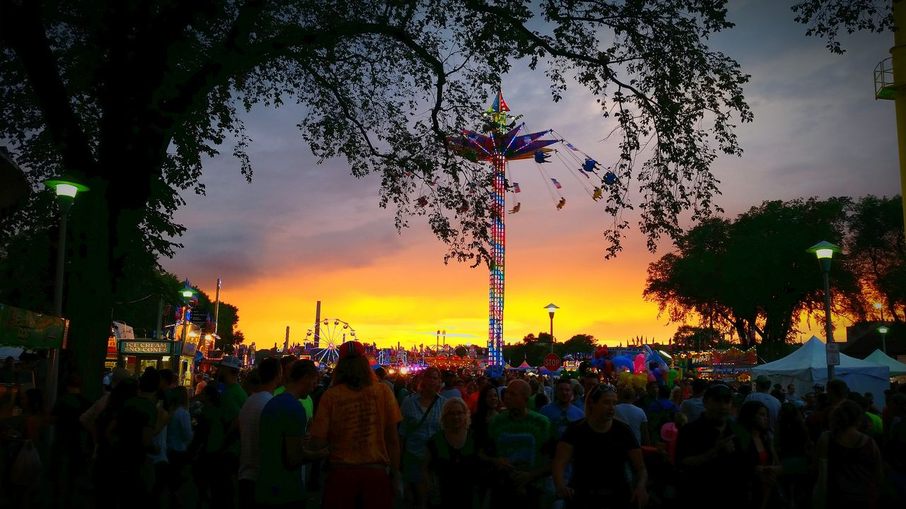 large group of people, real people, sky, tree, sunset, women, celebration, men, outdoors, cloud - sky, togetherness, leisure activity, lifestyles, crowd, building exterior, multi colored, nature, architecture, day, people