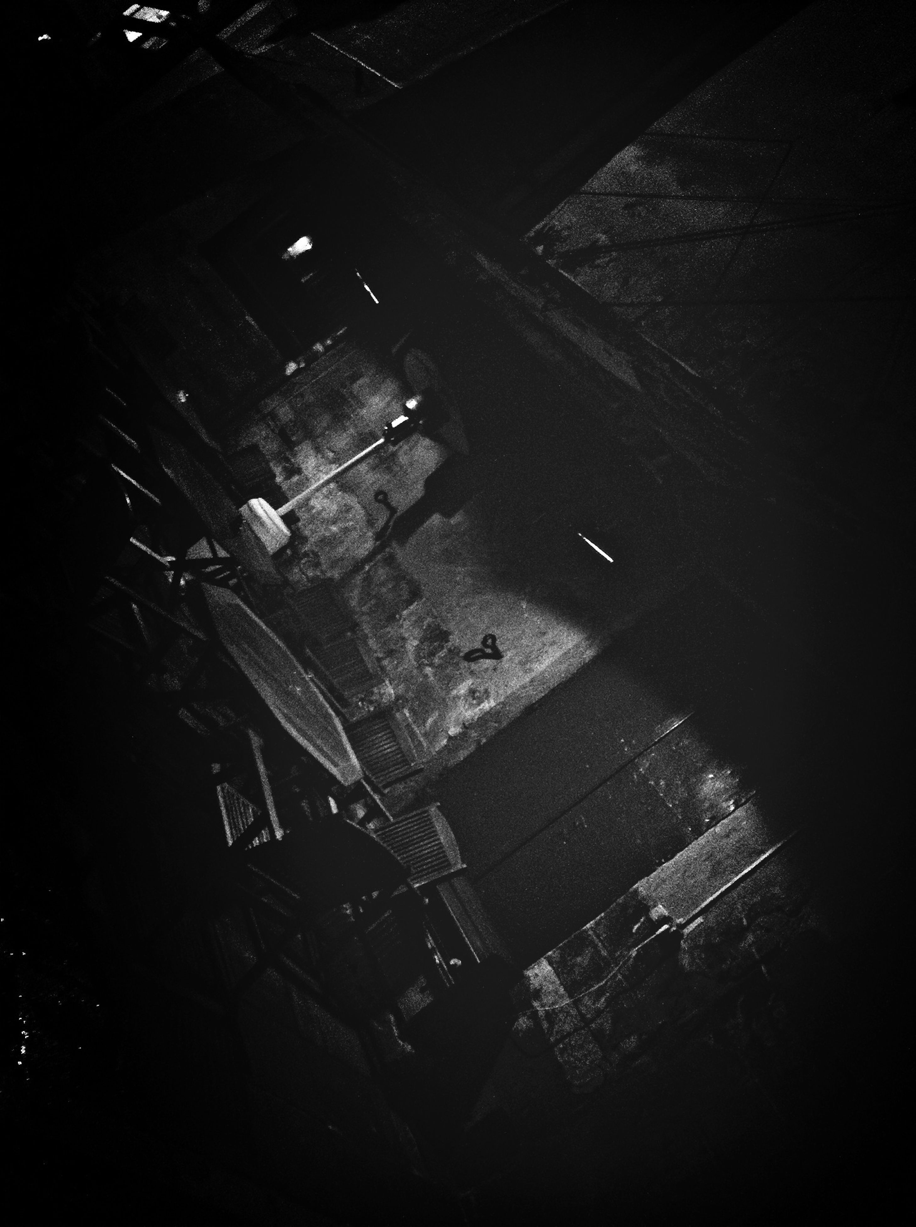 high angle view, night, built structure, architecture, shadow, street, building exterior, tilt, dark, sunlight, indoors, no people, abandoned, elevated view, road, transportation, auto post production filter, building