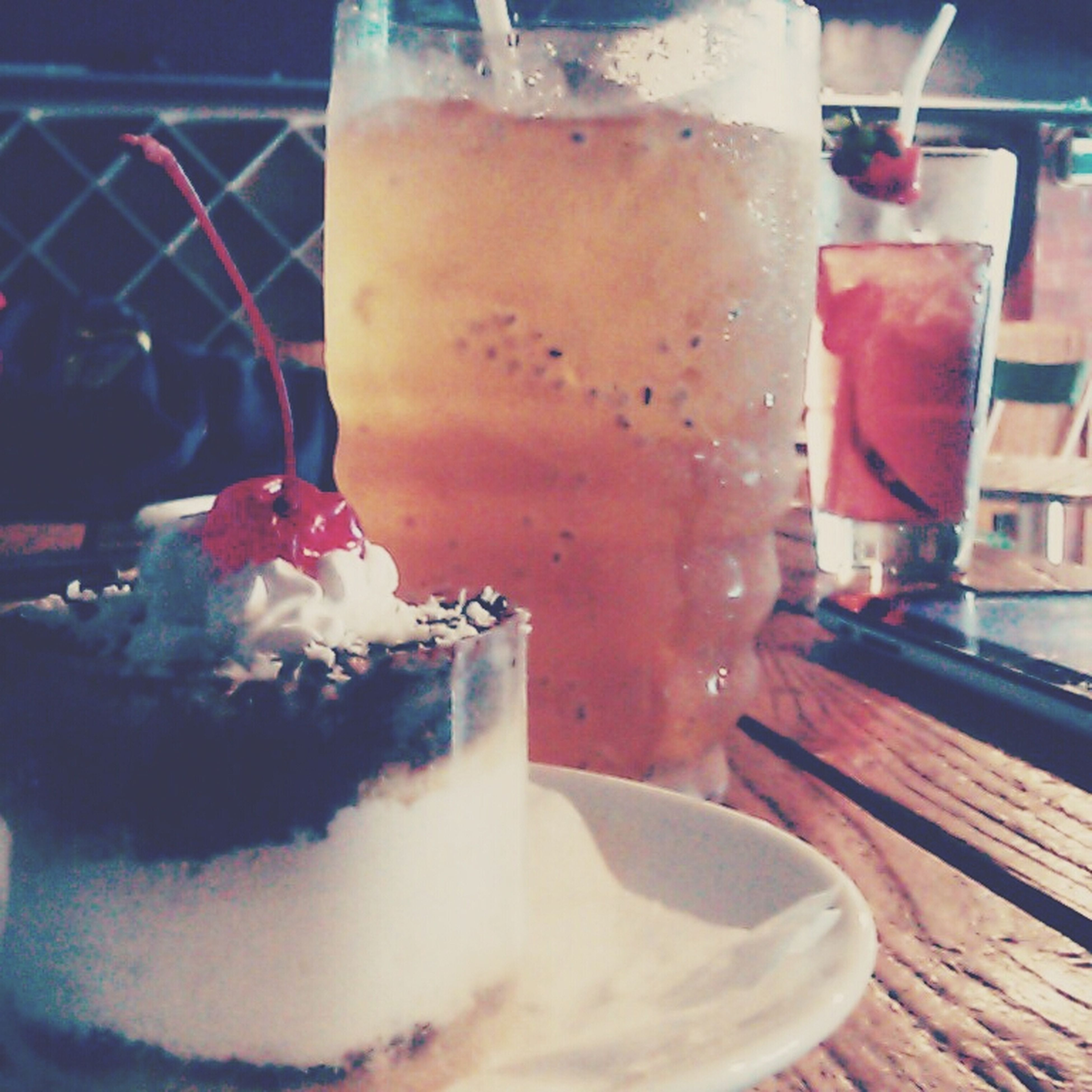 food and drink, freshness, drink, indoors, refreshment, table, close-up, drinking glass, still life, sweet food, food, indulgence, glass - material, focus on foreground, dessert, unhealthy eating, ready-to-eat, ice cream, restaurant