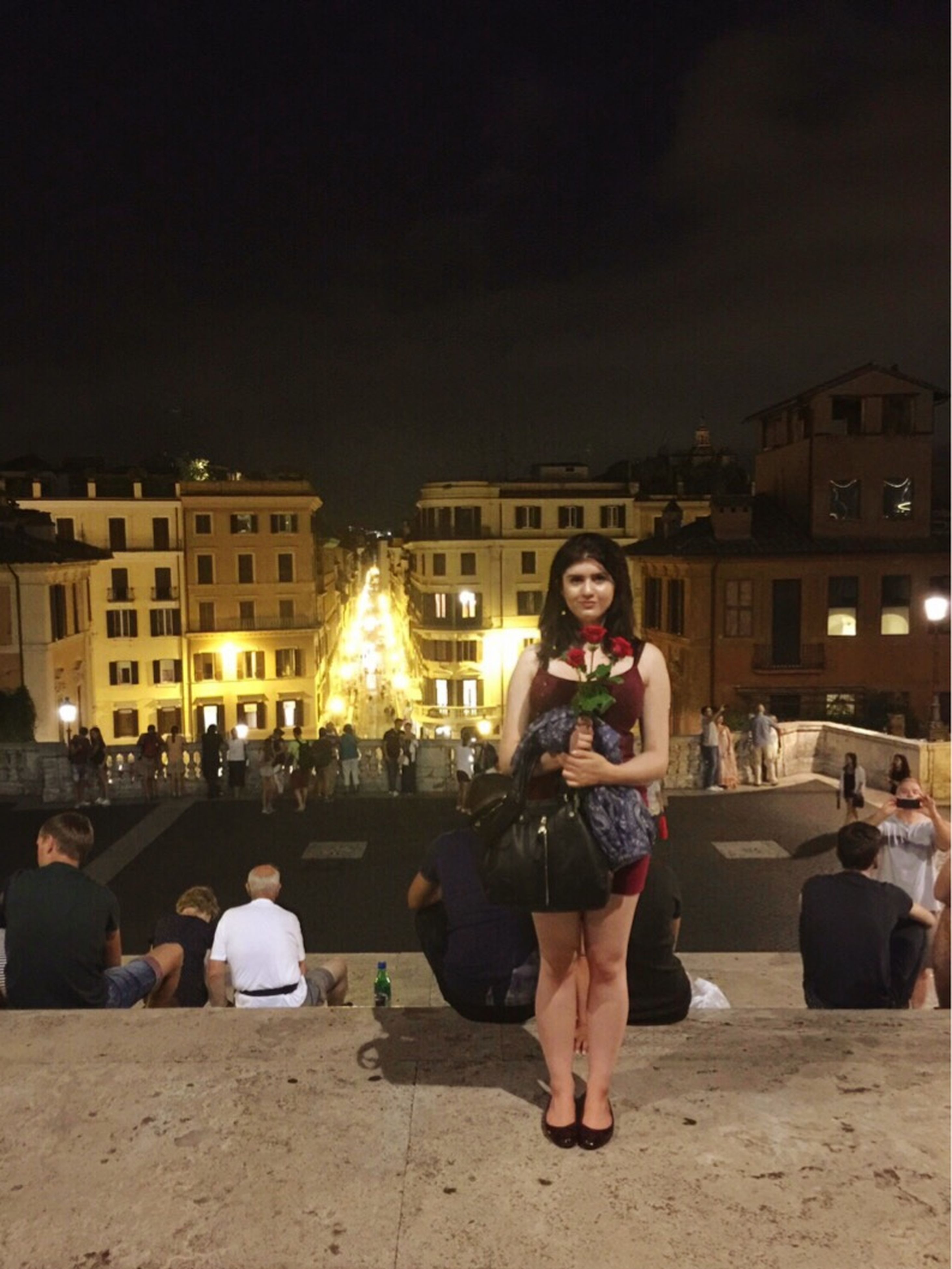 lifestyles, leisure activity, illuminated, night, building exterior, casual clothing, young adult, architecture, built structure, looking at camera, portrait, togetherness, young women, person, happiness, large group of people, front view, sitting, standing