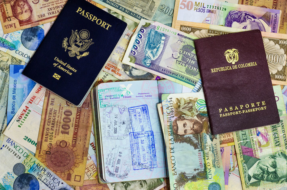 Three passports with various currencies from Latin America America Background Business Country Customs Destination Document Id Identification Identity Immigration International Official Pass Passport Security Stamp Tourism Travel USA Vacation Visa White World ınternational