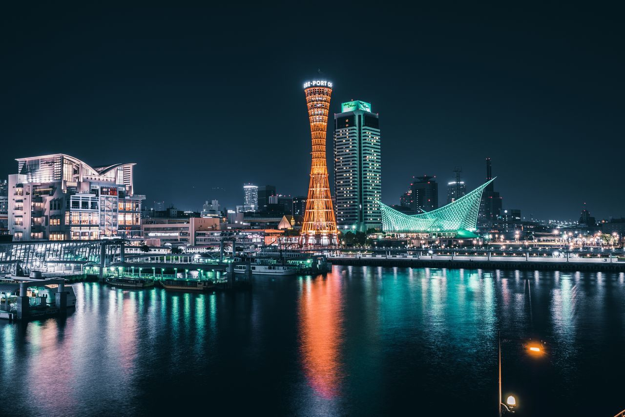 architecture, building exterior, night, illuminated, built structure, reflection, waterfront, skyscraper, city, travel destinations, cityscape, modern, water, no people, outdoors, clear sky, sky, urban skyline