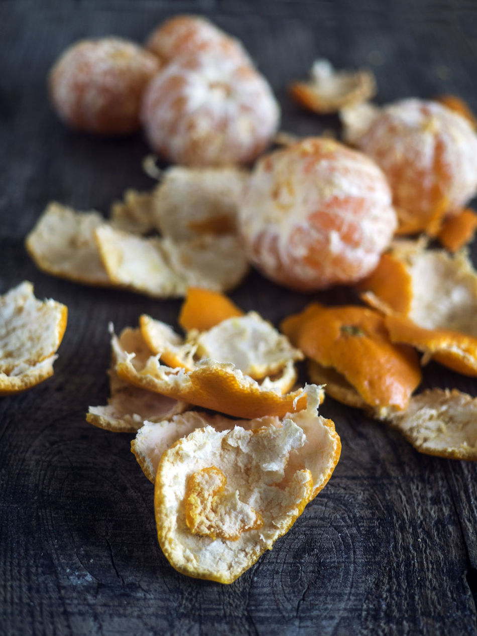 tangerine peel on old wooden background. slective focus Appetizer Background Baking Close-up Focus Focus On Foreground Food Food And Drink Freshness Full Frame Heap In A Row Indoors  Indulgence Old Peel Peel Ready-to-eat Selective Focus Slective Snack Tangerine Temptation Wooden