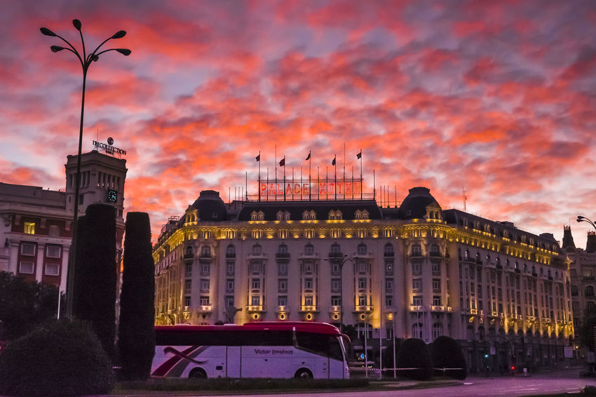 Sunset over a dark view of the Palace Hotel in Madrid. City City Street Cityscape Red Travelling Architecture Building Exterior Built Structure City City Lights City View  Cloud - Sky Clouds Evening Evening Sky Hotel Illuminated Night Outdoors Sky Sunset Tourism Tourism Destination Travel Destinations