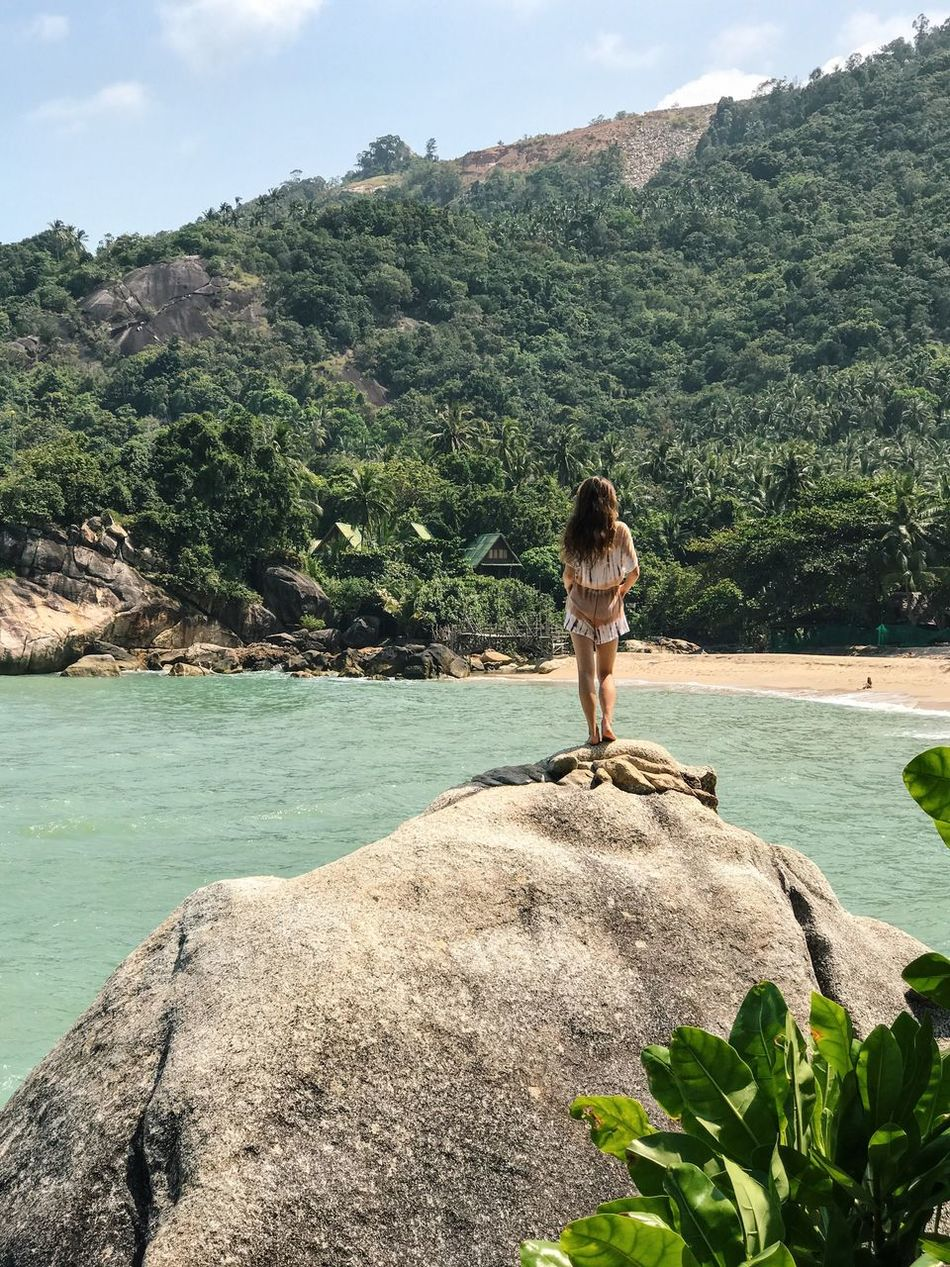 Rock - Object Sea Real People Tree Nature Lifestyles Beauty In Nature One Person Day Scenics Tranquility Leisure Activity Water Tranquil Scene Standing Outdoors Beach Sky People Athleisure Climbing Women Around The World Vacations Thailand Tourist