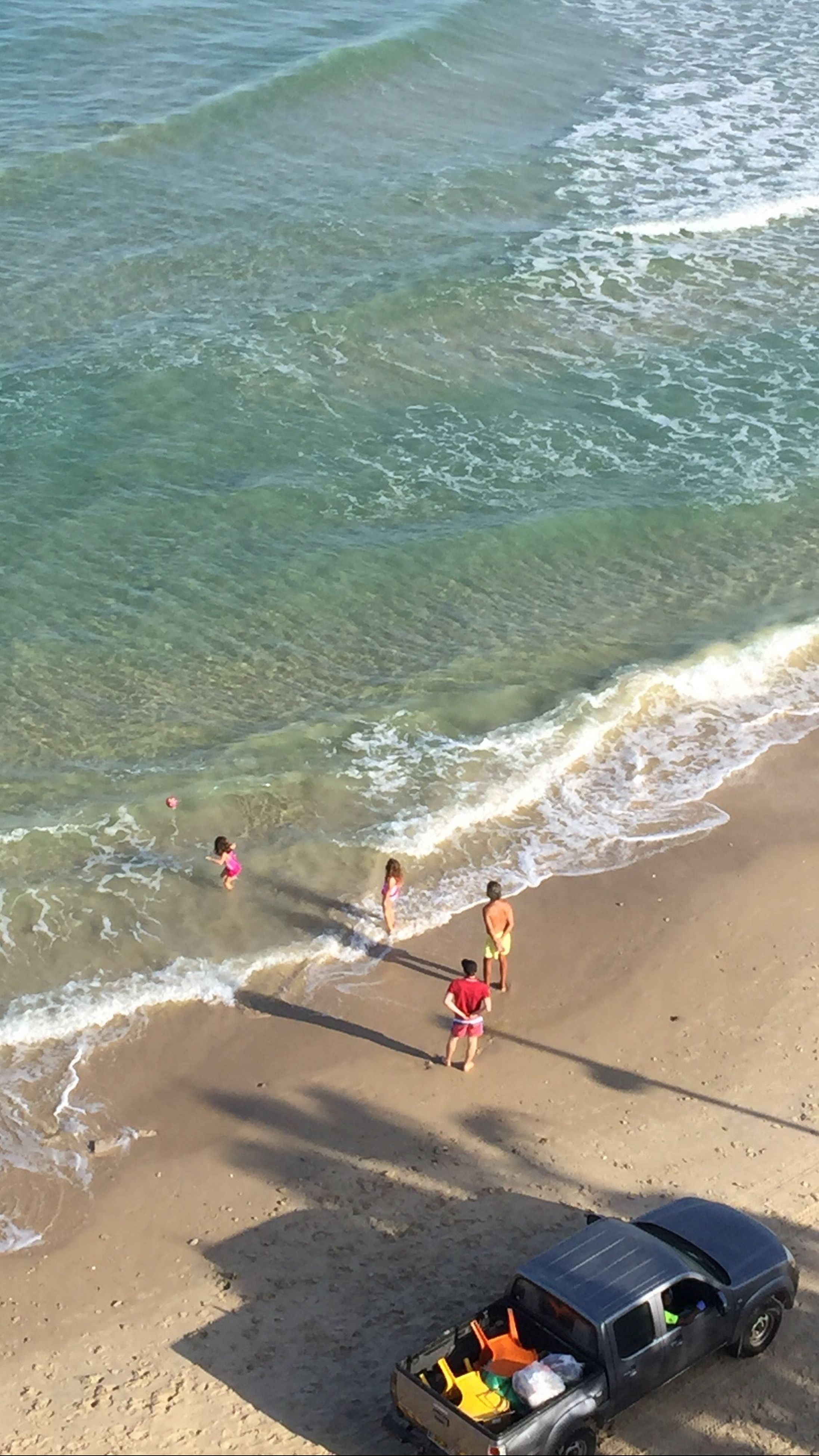 water, sea, beach, leisure activity, lifestyles, high angle view, shore, wave, surf, vacations, sand, enjoyment, summer, men, weekend activities, motion, nature, day, fun