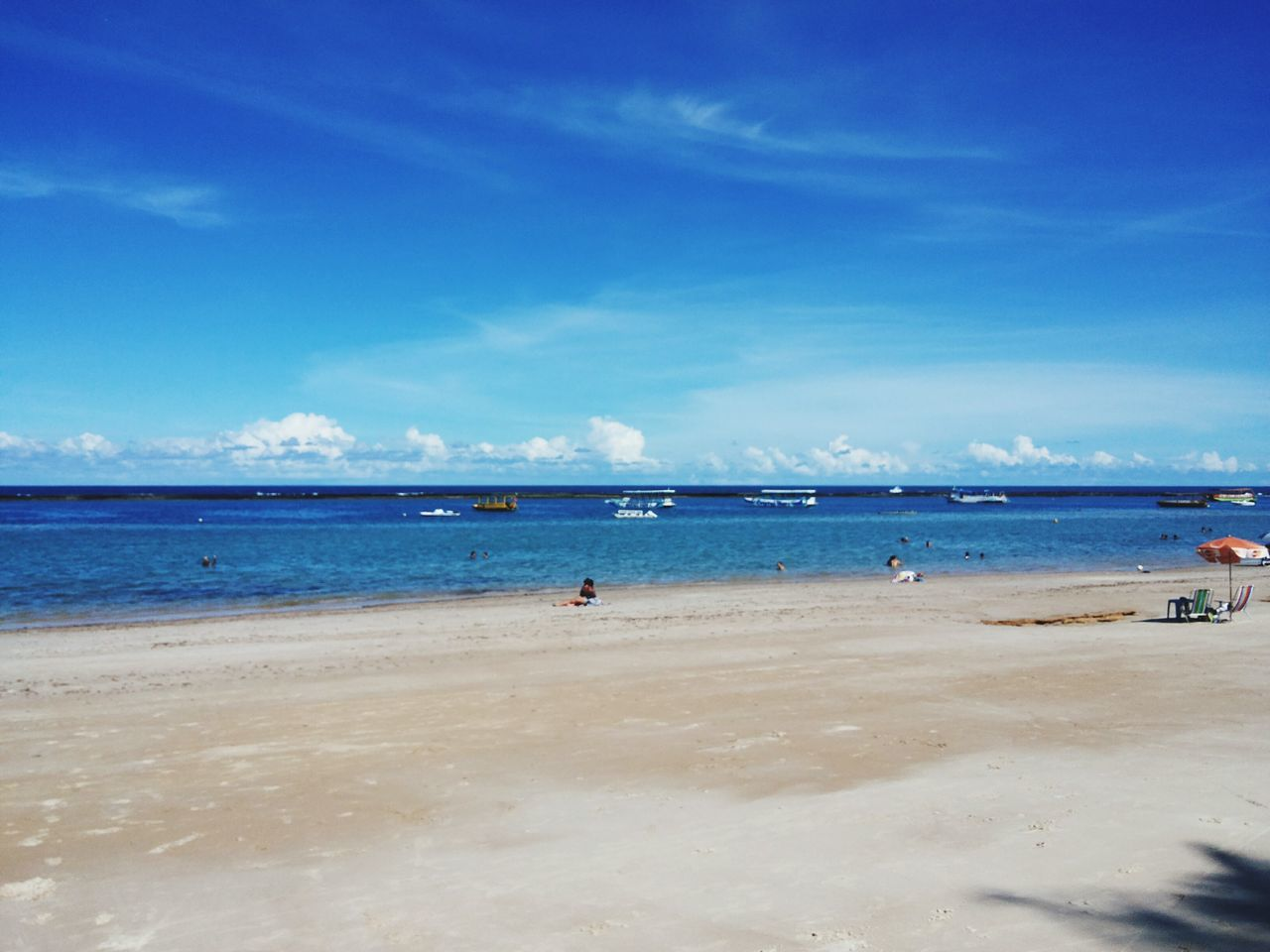 sea, beach, sky, water, sand, scenics, beauty in nature, horizon over water, nature, blue, cloud - sky, day, tranquility, outdoors, vacations, no people, jet boat