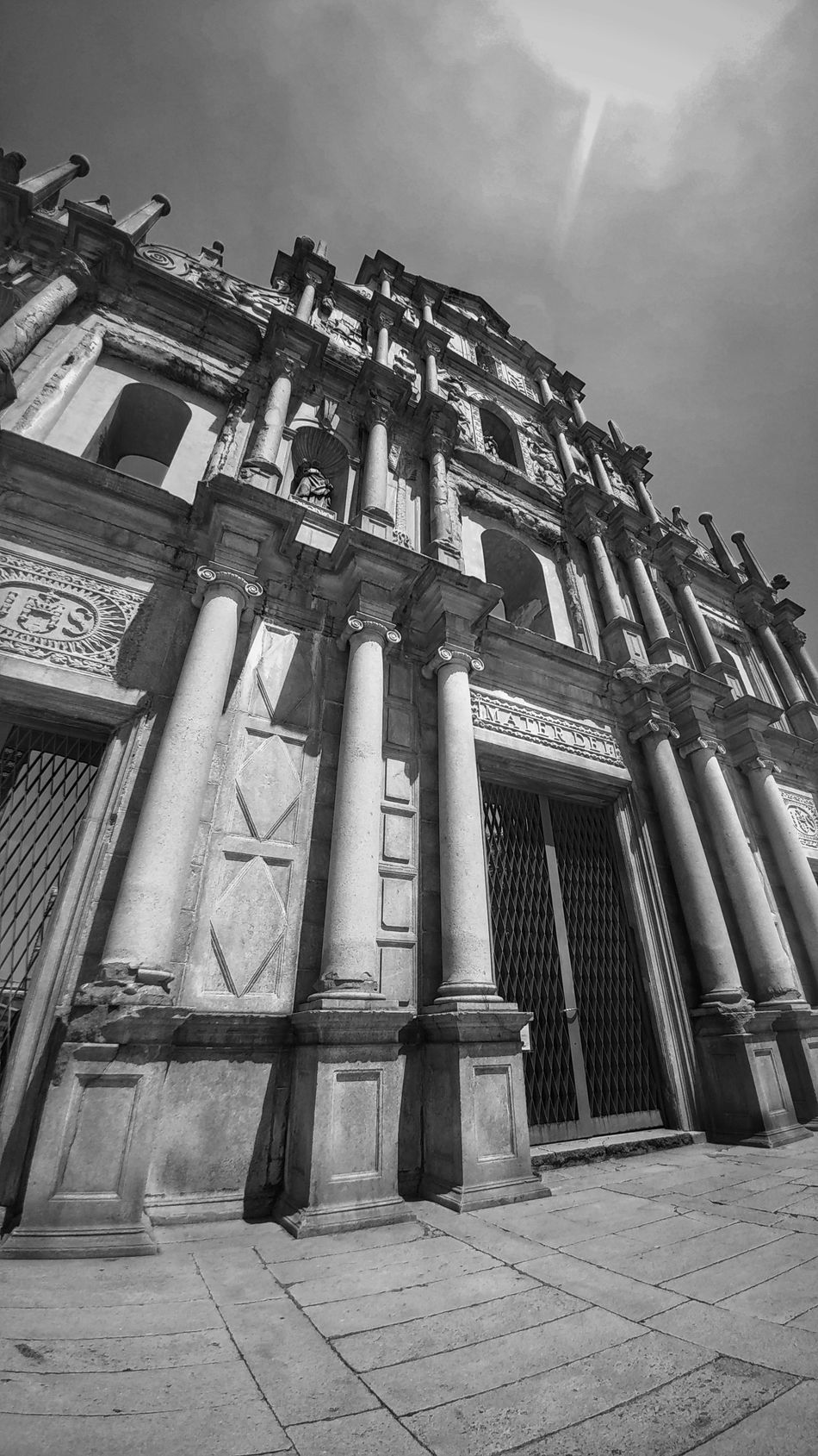 Architecture Built Structure Building Exterior Low Angle View History Sky Church Architectural Column Place Of Worship Day Outdoors Sunbeam Industry The Past Façade Obsolete Ancient Tall - High Monochrome Photography Monochromatic Monochrome Black And White Photography