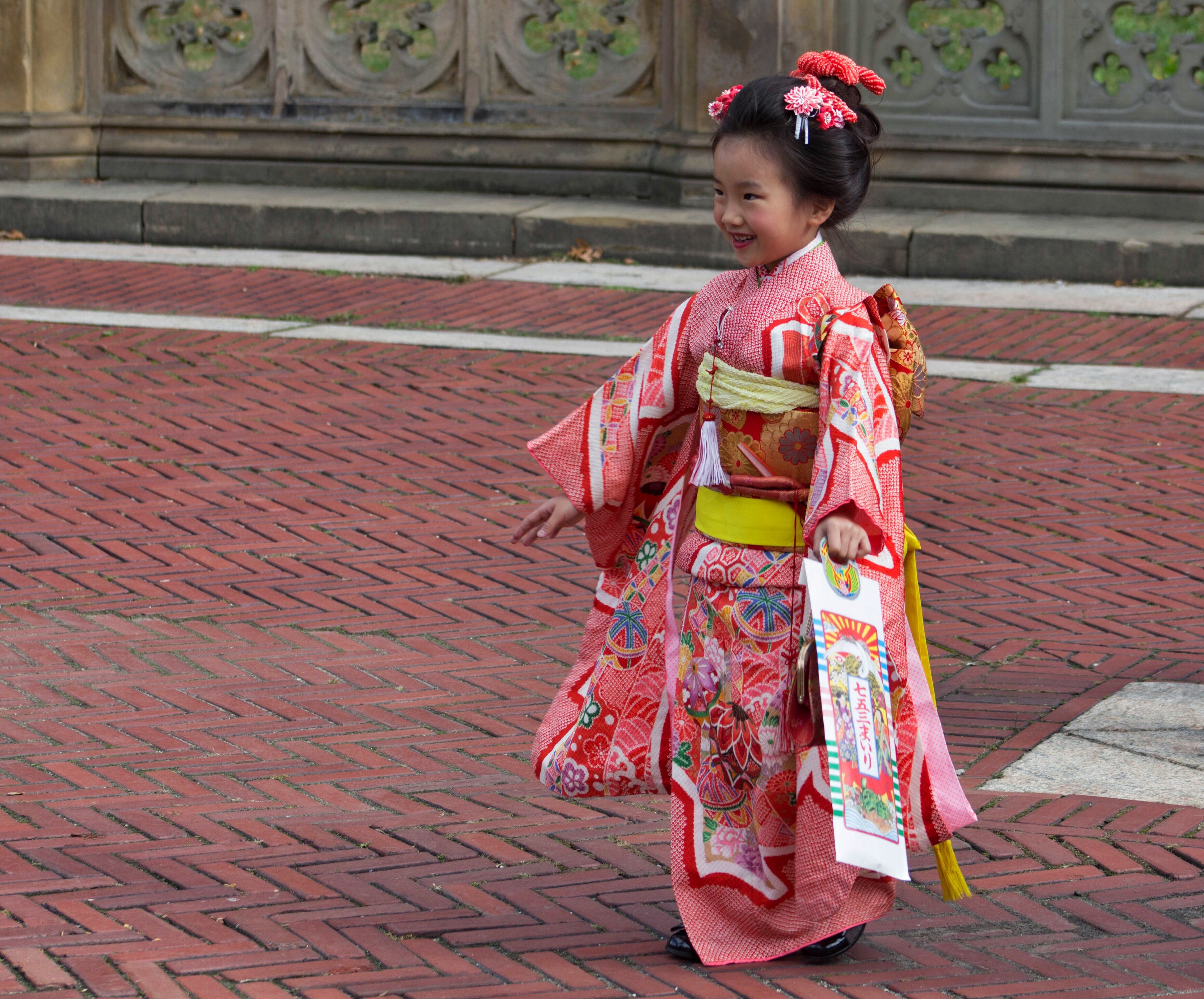 child, traditional clothing, sitting, tradition, arts culture and entertainment, performance, one person, period costume, people, outdoors, adult, day