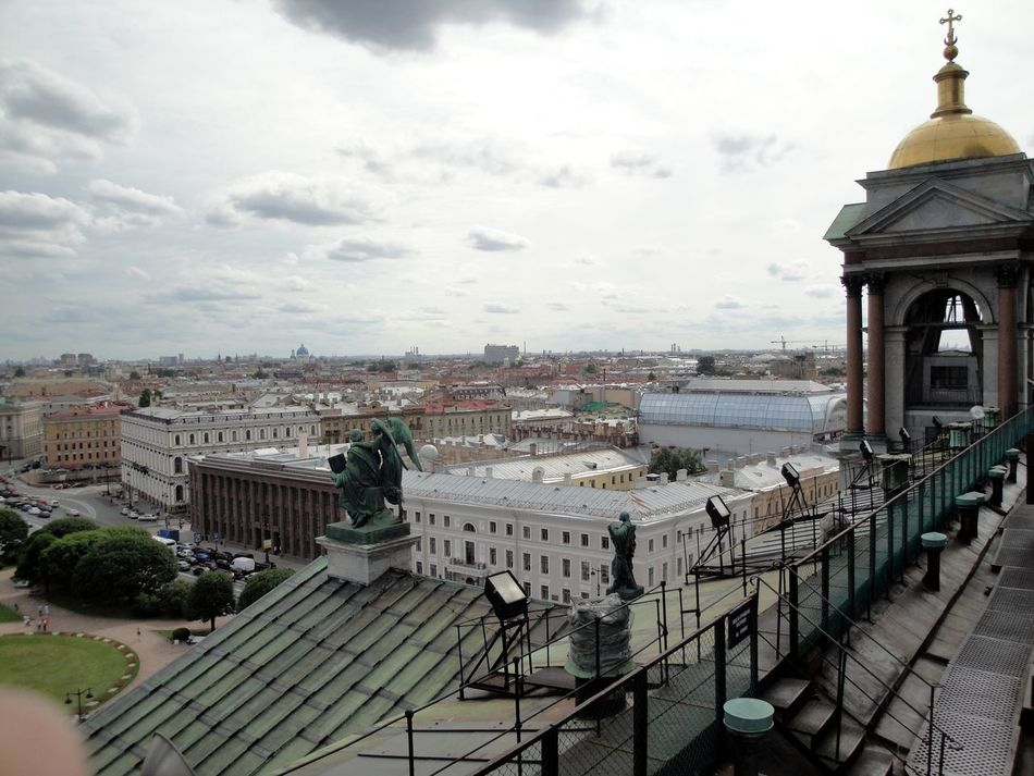 Architecture Building Exterior Built Structure City City Life Cityscape Cloud Cloud - Sky Cloudy Day Dome No People Outdoors Residential Building Residential District Residential Structure Roof Saint Isaac's Cathedral Saint Petersburg Sky Tourism Town TOWNSCAPE Travel Destinations