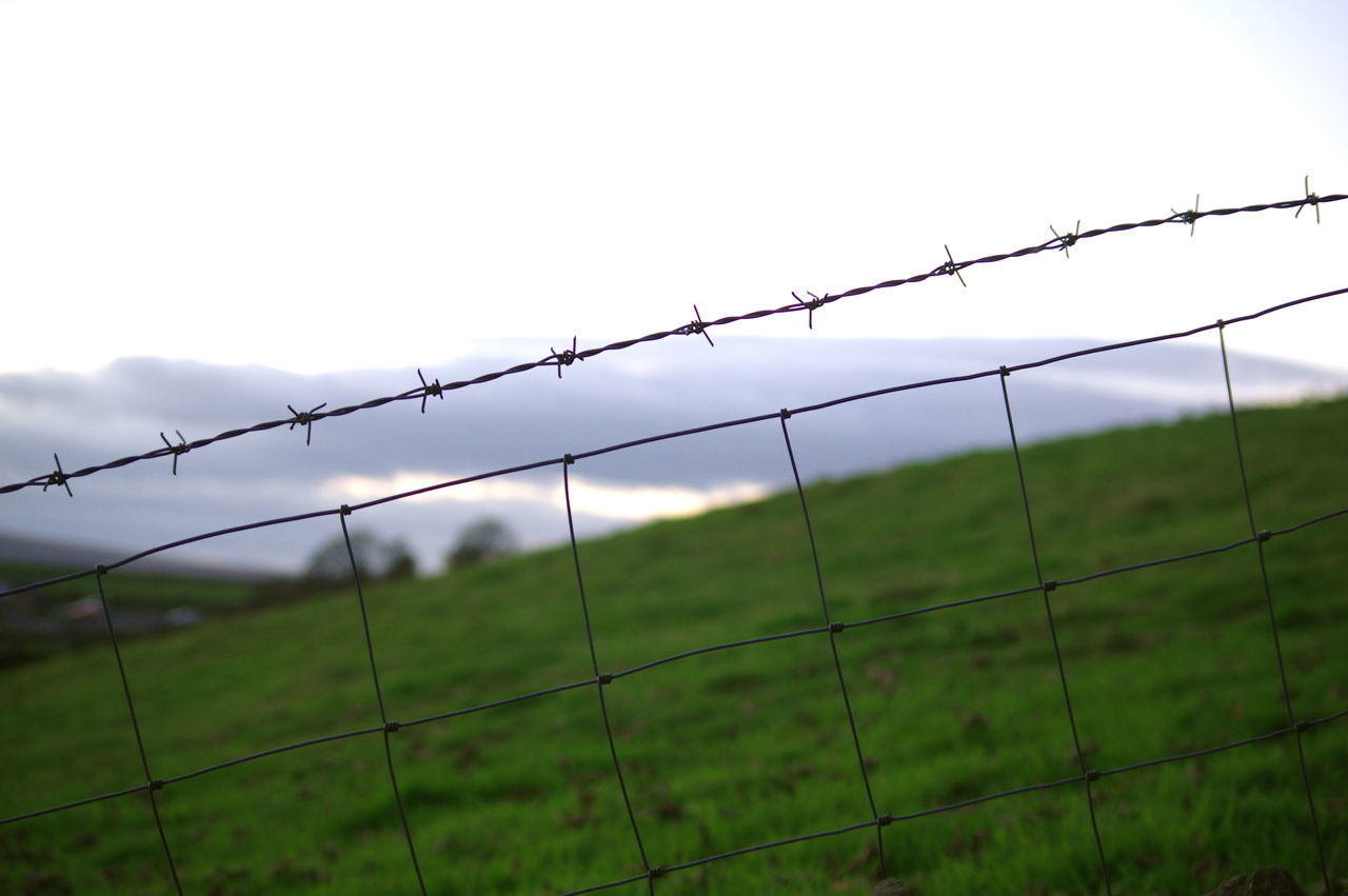 Security Fence Protection Barbed Wire Separation Metal Boundary Landscape Tranquil Scene No People Nature Close-up Day Outdoors Grass Sky Clear Sky Yorkshire Atmospheric Mood Hill Contrast In Nature Autumn Light And Shadow Full Frame Diagonal