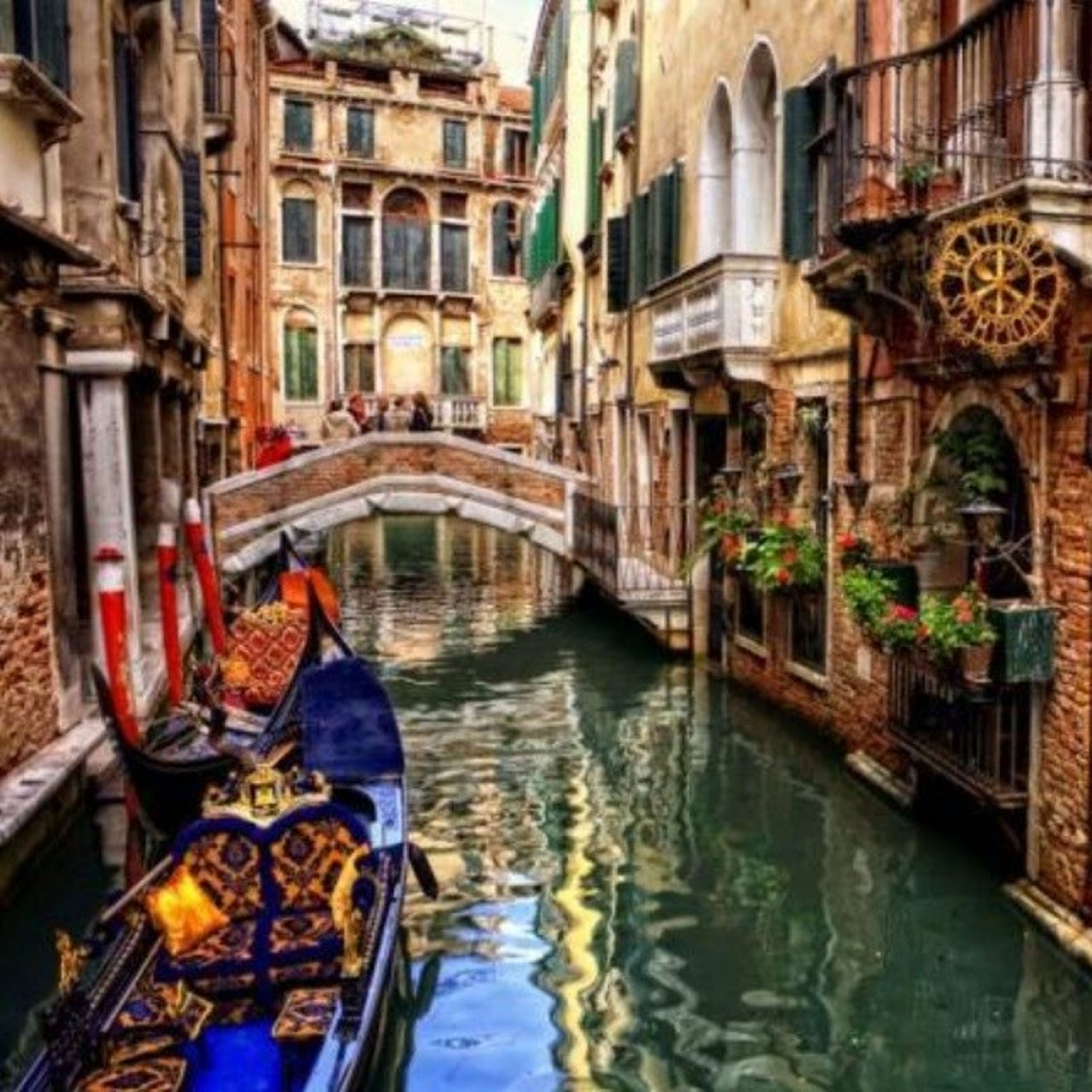 architecture, water, built structure, canal, building exterior, waterfront, reflection, bridge - man made structure, connection, arch, river, transportation, arch bridge, city, nautical vessel, residential building, building, travel destinations, incidental people, residential structure