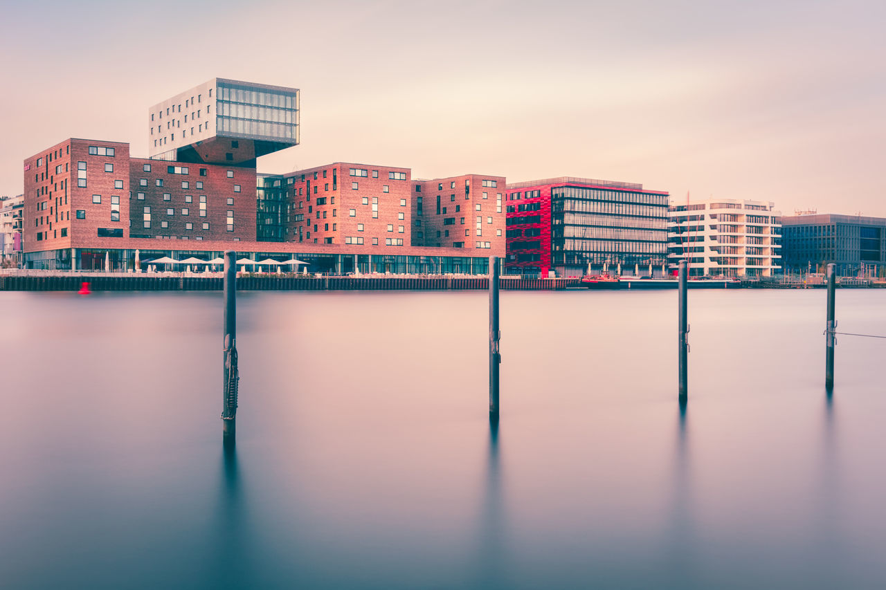 Berlin East-Harbor Architecture Berlin Berlin City Building Built Structure City Cityscapes Cloud Day Germany Longexposurephotography Mediaspree No People Osthafen Outdoors Philipp D Pole Reflection Scenics Sky Spree River Sunset Tranquil Scene Tranquility Water