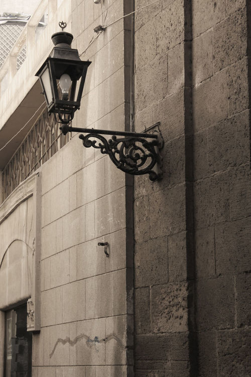 Mo'ez Street Architecture Building Exterior Built Structure City Day Egypt Low Angle View Moezstreet No People Old Cairo Outdoors Sepia Wall Lamp