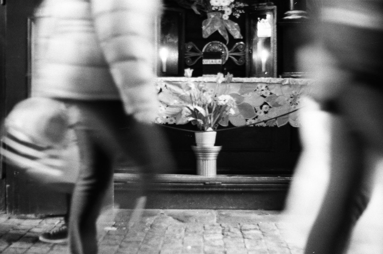 blurred motion, real people, low section, selective focus, motion, day, one person, indoors, close-up, men, people
