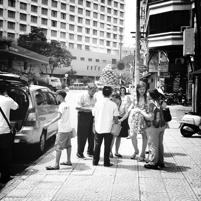 The man is lift food on head without hand...amazing... Saigon Monochrome Urban Exploration Street Photography