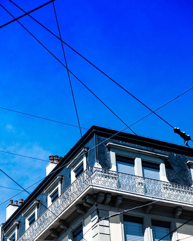 Architecture Blue Built Structure Cable Day Geneva High Section Low Angle View No People Outdoors Sky Wires Wires In The Sky