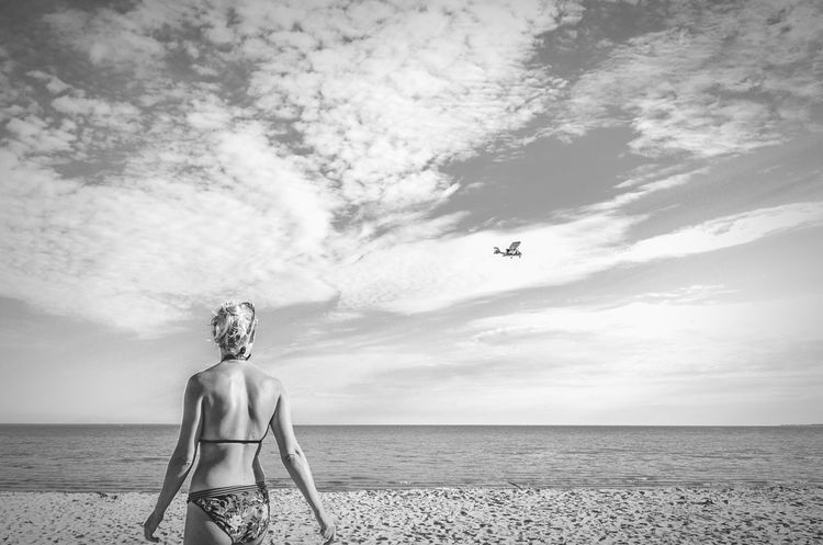 She dreams of the summer that was. Woman On The Shore Bikini Plane Spotting Beautiful Woman Woman On The Beach Girl Coast Sea Beach Wear Beach Life Plane Flying Young Woman Valgranna Beach Pärnu Estonia Seascape Ocean Beauty Monochrome Photography Monochrome Black And White Woman Shore Model Blonde Investing In Quality Of Life Mix Yourself A Good Time Mix Yourself A Good Time
