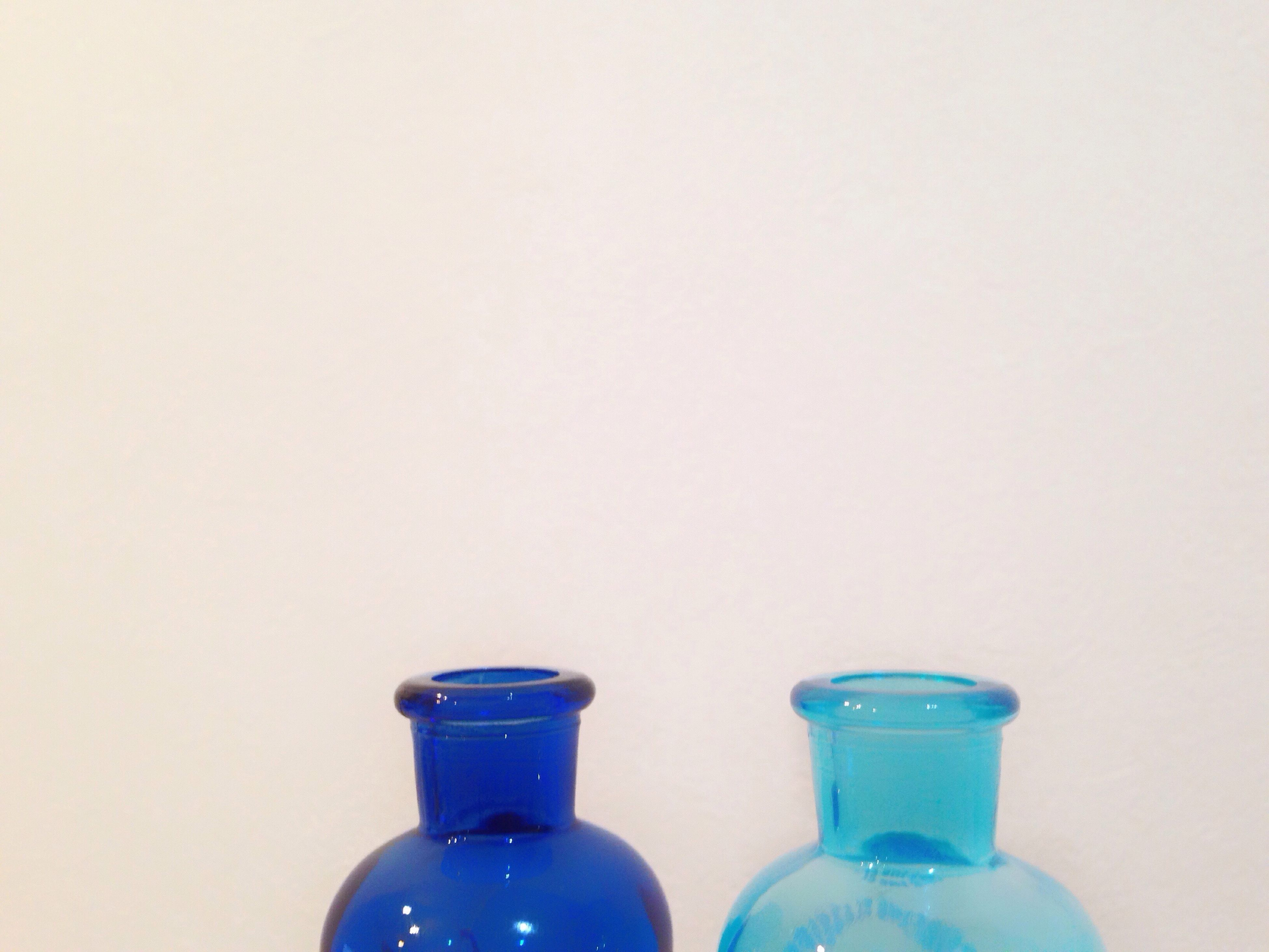 copy space, studio shot, white background, no people, bottle, close-up, indoors, day