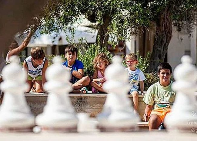 Playing Chess in Sanvitolocapo Couscousfest Child Childrenphoto Girly Boy Game Igers Igersicilia Igerspalermo Igerstrapani Sicily Sicilia Summer Sea Landscape Happy Relaxing Photo Photooftheday VSCO All_shots Instagood instadaily instagram