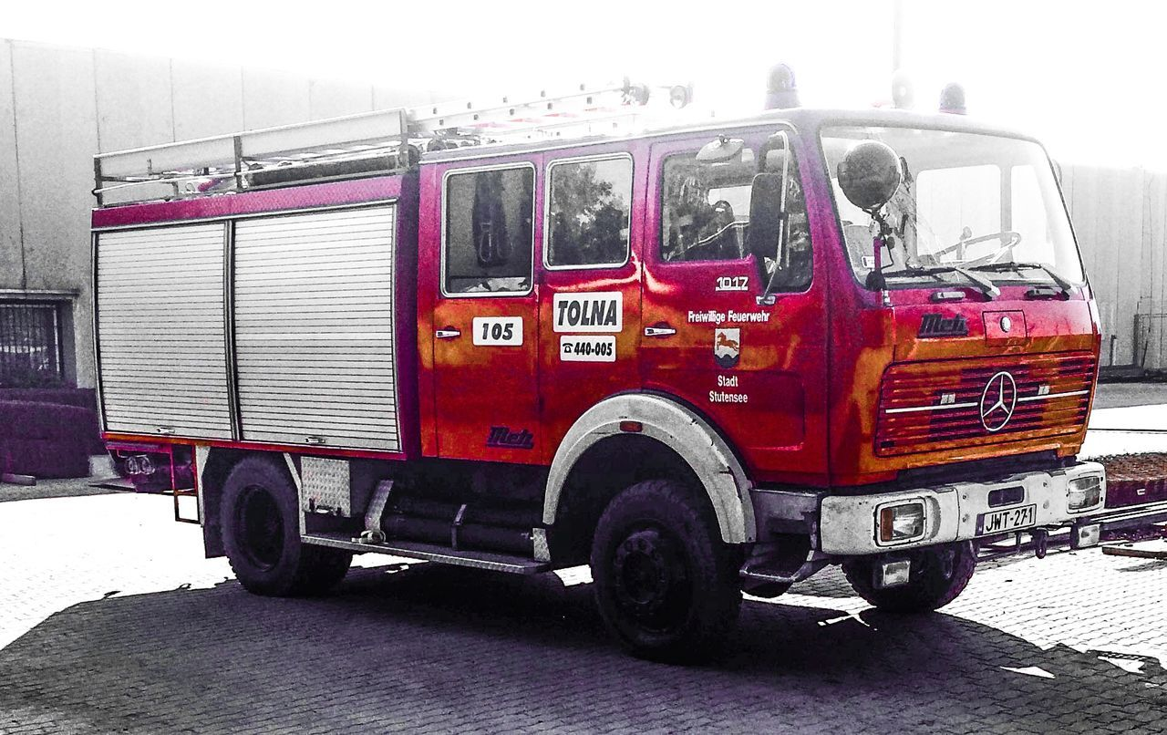 red, transportation, land vehicle, outdoors, fire engine, day, no people, sky
