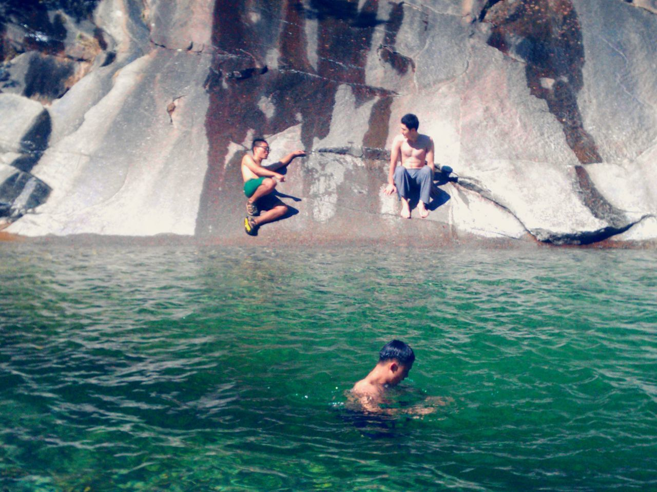 adventure, rock - object, sea, full length, water, extreme sports, swimming, cliff, sport, nature, day, outdoors, adult, men, togetherness, people, young women, young adult, adults only