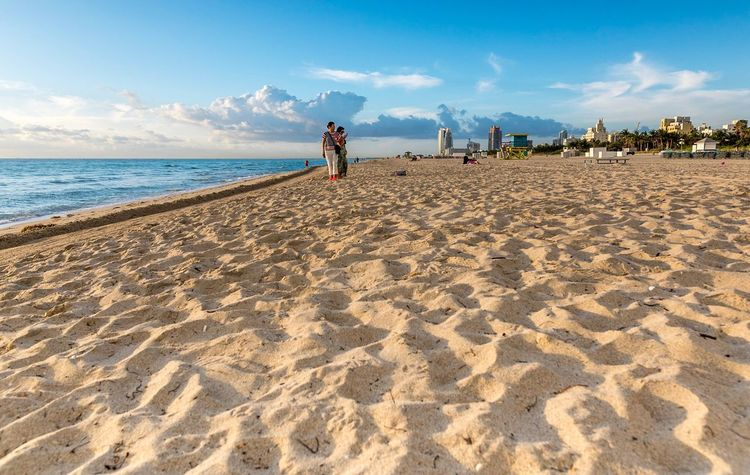 Beach Sea Sky Sand Horizon Over Water Real People Cloud - Sky Outdoors Lifestyles Water Sunlight Leisure Activity Two People Day Vacations Togetherness Nature Full Length Beauty In Nature Scenics Sunrise Miami Beach USA Nature