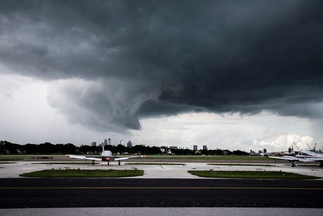 Storm Florida Tampa City City Life Airport Airplane Florida Life Storm Cloud Weather Dark Stormy Weather Weather Photography Cloud - Sky Sky Nature Outdoors Thunderstorm Storm Beauty In Nature Robertbenderphotography Rain Rainy Days Flight Cloudy