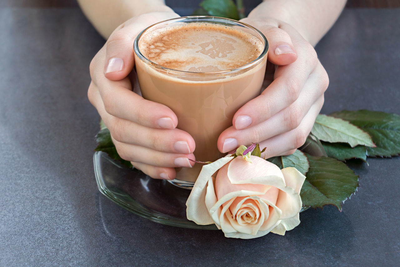 A cup of coffee in hands Morning Rituals Ritual Food Drink Beverage Coffee Cup Girl Pink Rose Love Togetherness Dateday Surprise Date Gift Hand Hands Couple Temtation Sadness Flowers Rose In Hand Table Separation Parting