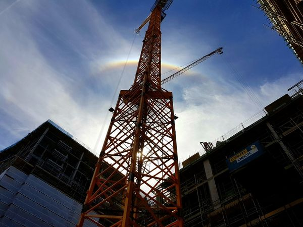Construction Construction Site Tower Cranes Rainbow Rainbow Sky Low Angle View Built Structure Outdoors Working