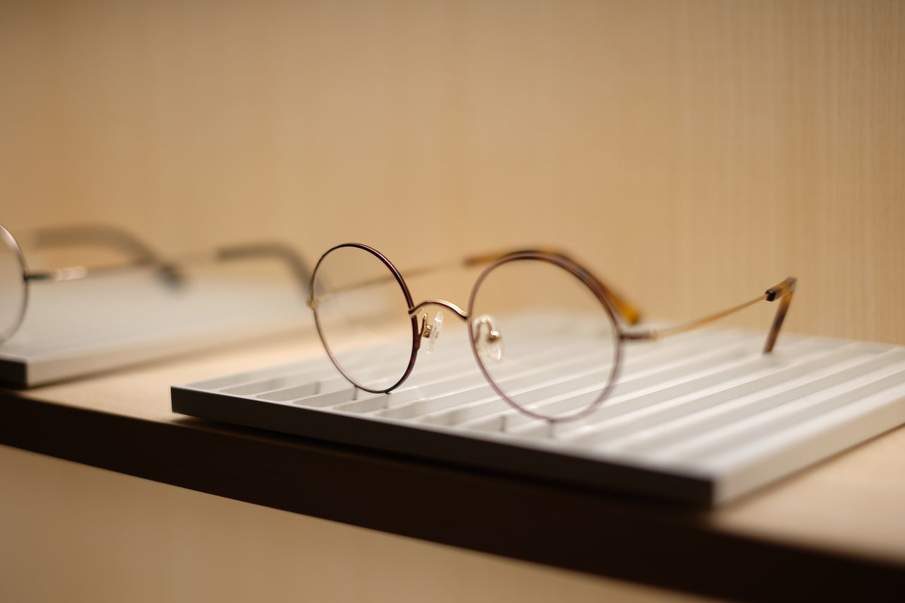 still life, eyeglasses, table, indoors, no people, close-up, vision, book, technology, day