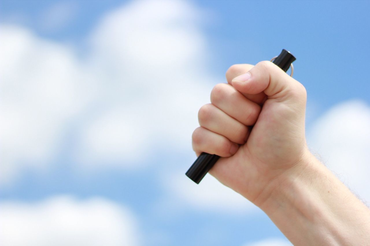 Kubotan Human Hand Human Body Part Sky Cloud - Sky One Person Day Outdoors Close-up People Adult Krav Maga Stick Hand Weapon Selfdefense Fight Real People Men Midsection Holding One Man Only Beauty In Nature