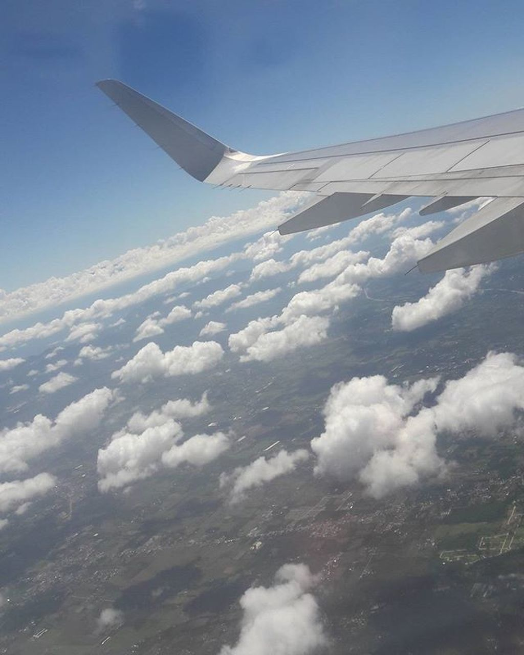 airplane, flying, transportation, cloud - sky, nature, sky, day, white color, aerial view, no people, airplane wing, journey, air vehicle, scenics, blue, beauty in nature, outdoors, mid-air, tranquility, aircraft wing