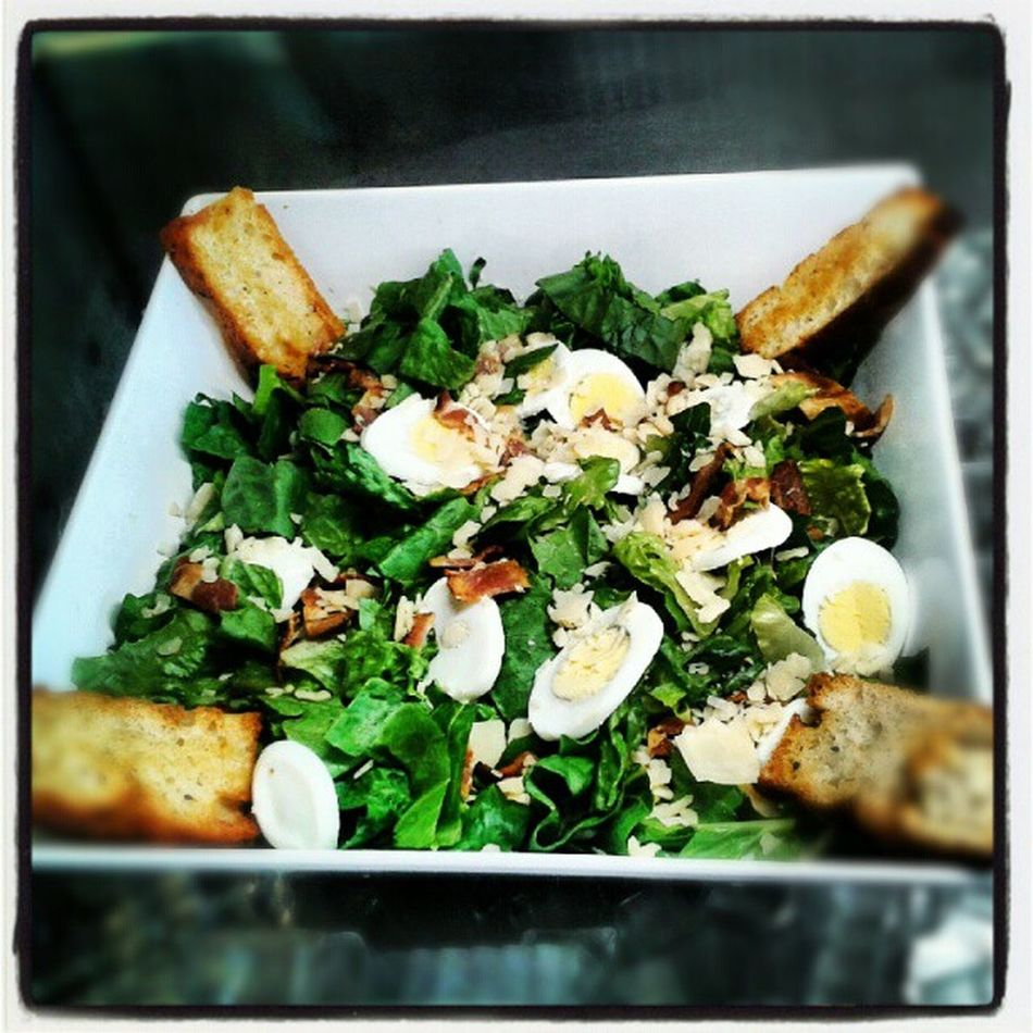 Ceasar salad with egg, bacon, parmesan cheese! Topped with fresh organic focaccia crouton! Bushfiregrill Healthy Classic