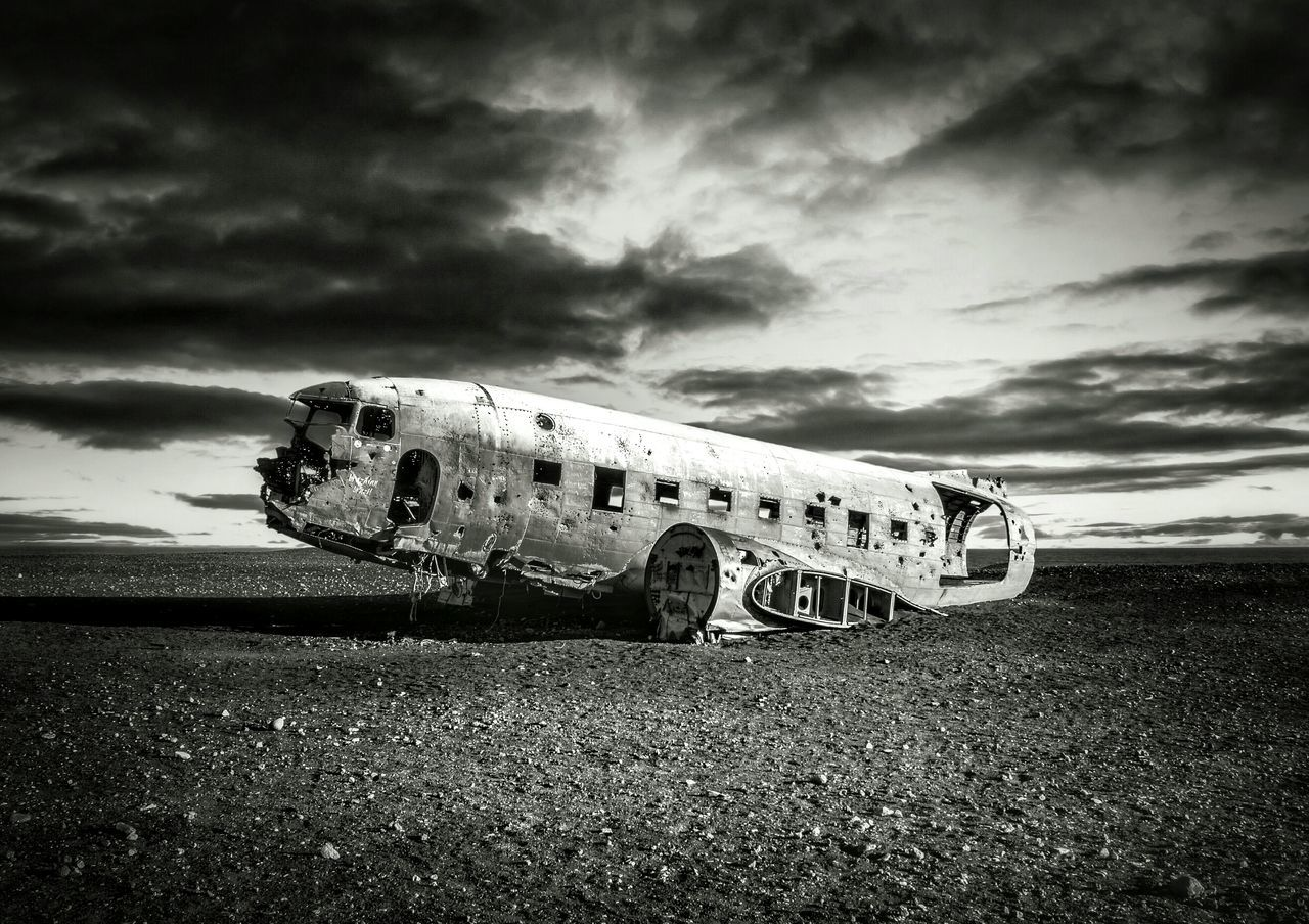 Airplane Wreckage At Solheimasandur Beach Against Cloudy Sky