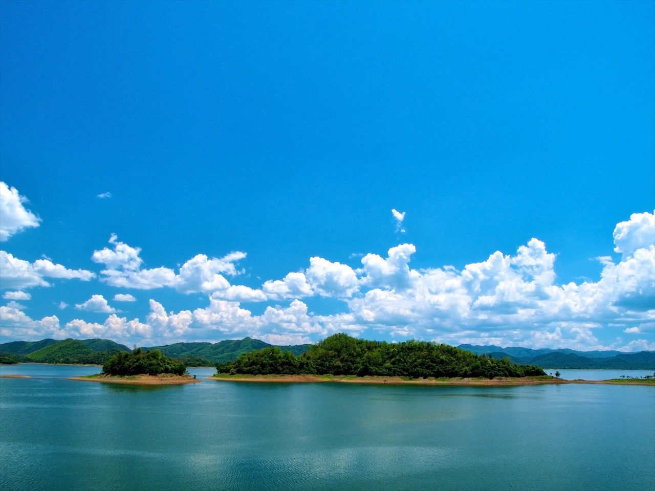 scenics, beauty in nature, water, sky, nature, tranquil scene, cloud - sky, blue, waterfront, tranquility, outdoors, day, sea, no people, tree, mountain