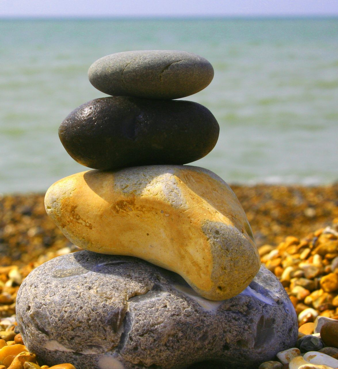 Close-Up Of Pebble Stack At Beach