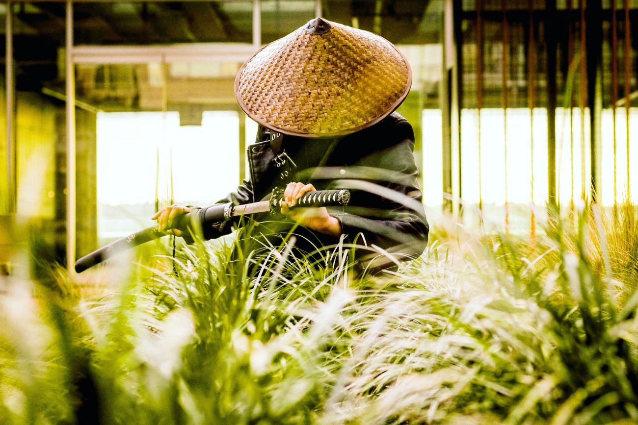 Killing it Grass One Person Sunlight Outdoors Real People Plant Day Growth Nature Headwear People Warm Colorful Architectural Detail Angle Composition Pastel Pattern Textures And Surfaces Light And Shadow Depthoffield Abstract Textured  Style Clothing
