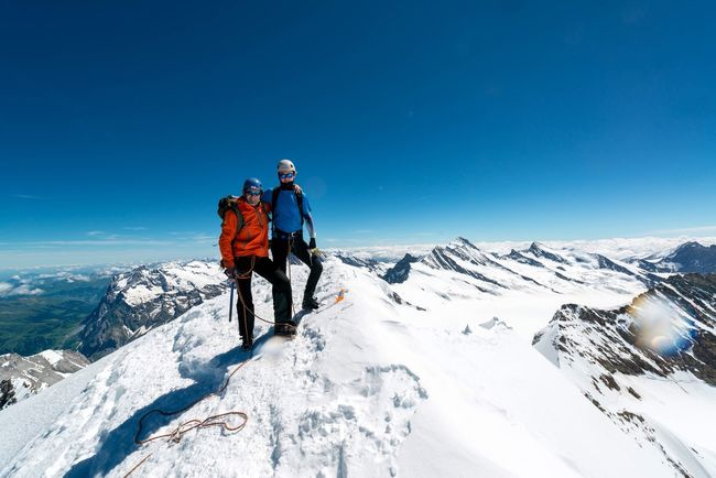 My dad and me on the summit Mountain Mönch Jungfrau Alps Climbing Blue Family Dad