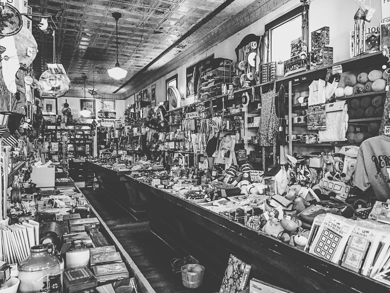 At the oldest Five and Dime in the U.S., ISpy  an American flag, a frying pan, a Viking hat, a clothes pin, some fishing bobbers, the John Deere logo, and a sock monkey couple... Bnw_friday_eyeemchallenge EyeEmSpy Blackandwhite Black And White Black & White Fortheloveofblackandwhite Fiveanddime IPhoneography Eye4photography