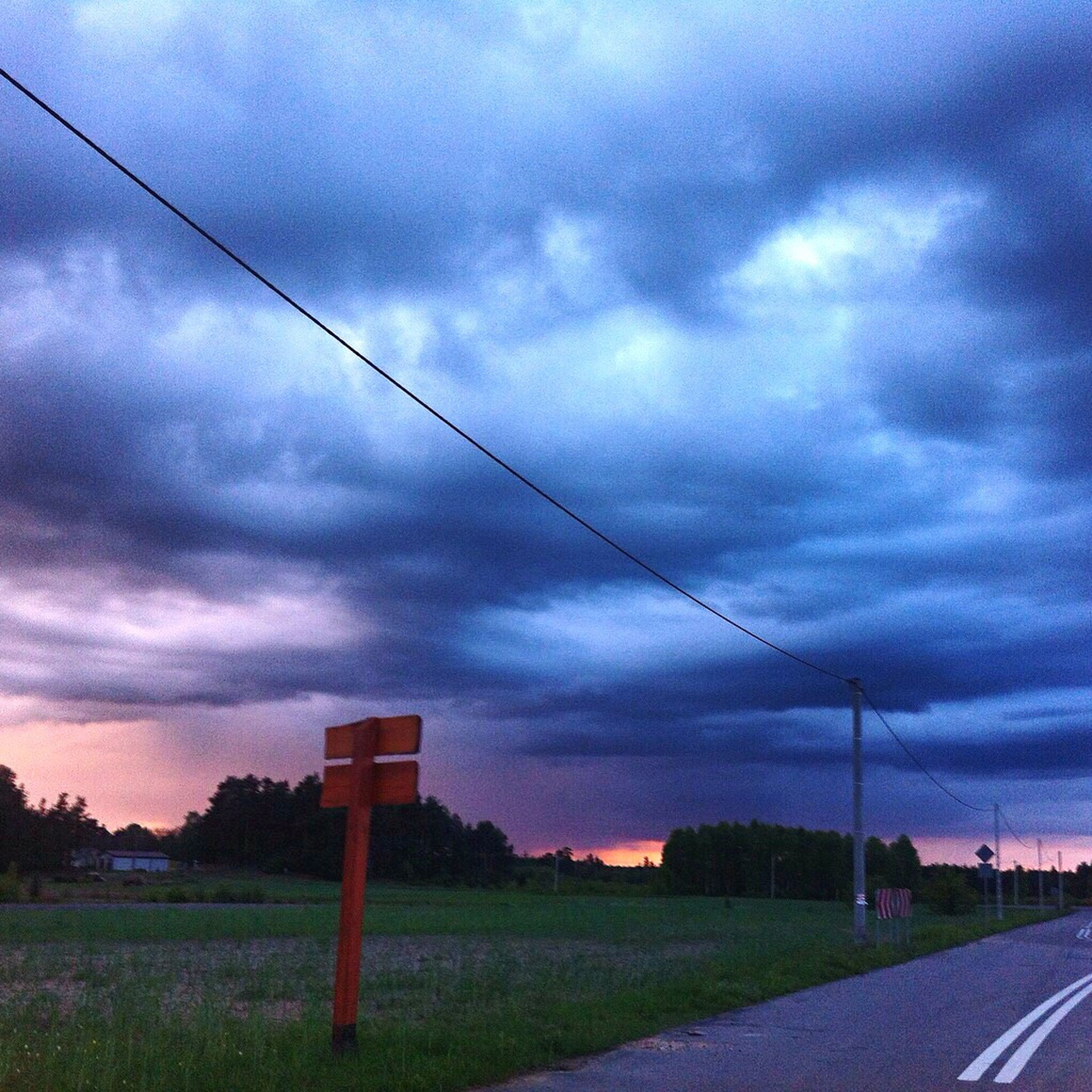 sky, cloud - sky, cloudy, landscape, field, electricity pylon, cloud, road, power line, tranquil scene, tranquility, overcast, rural scene, nature, scenics, the way forward, weather, dramatic sky, connection, electricity