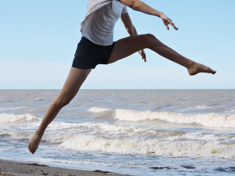 Fitness Woman Slim Motion Sprinting Jumping Running Energy Sports Sport Sea Real People Lifestyles Horizon Over Water Mid-air Beach One Person Full Length Leisure Activity Clear Sky Day Water Outdoors Nature Sky