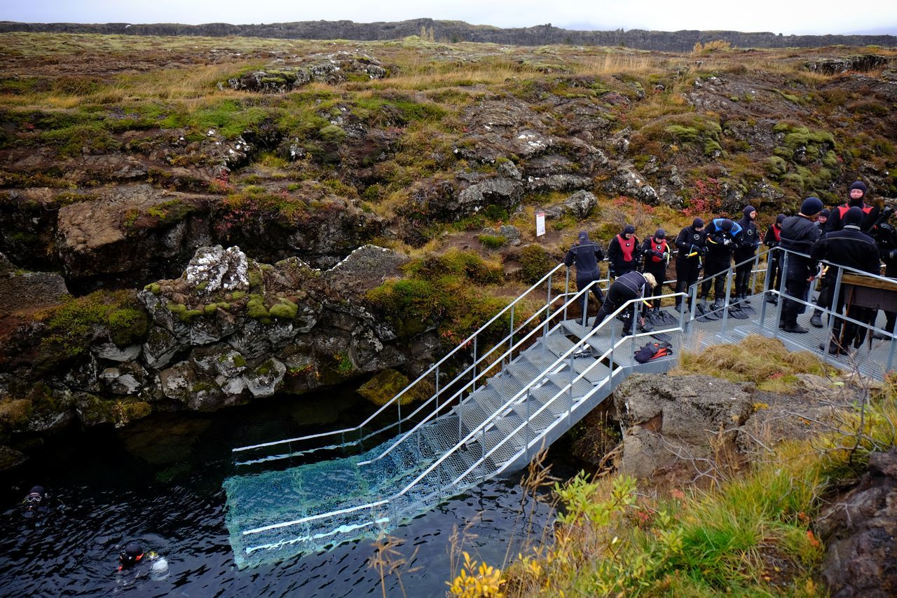 Diving between the North American and Eurasian tectonic plates at Silfra Silfra Adults Tectonicplate Divers Nature National Park High Angle View Leisure Activity Water People Thingvellir National Park þingvellir Iceland