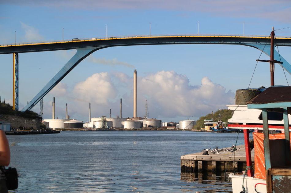 Architecture Bridge Building Exterior Built Structure Cloud - Sky Day Harbor Large Bridge No People Outdoors Refinery Sky Water Waterfront