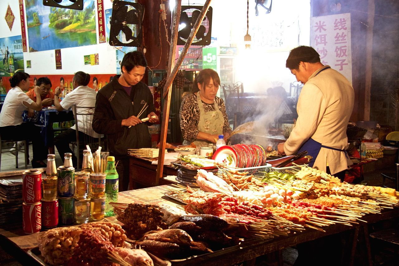 market stall, market, retail, for sale, small business, real people, market vendor, buying, food and drink, men, choice, food, customer, outdoors, standing, day, consumerism, freshness, occupation, one person, people